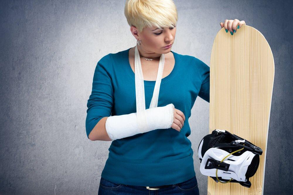 Unhappy snowboarder with broken arm